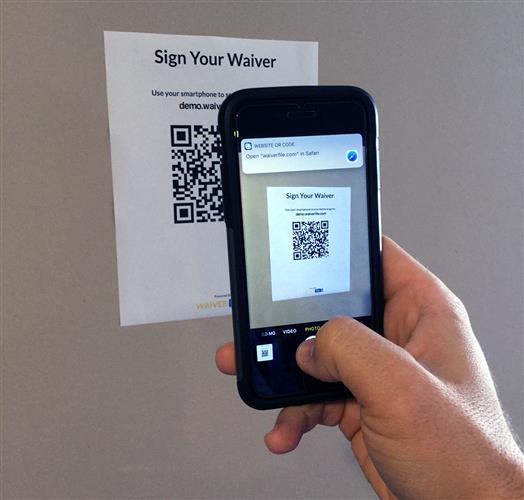 Scanning Waiver Form QR Code on an iPhone